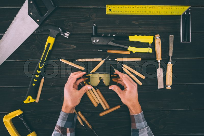 Aerial view of carpenter man with working tools equipment set