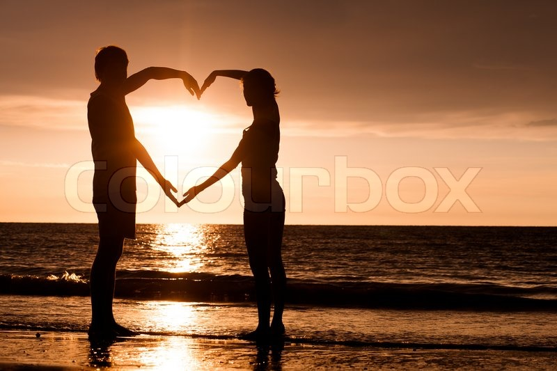 Silhouette of two people in love at sunset | Stock Photo ...