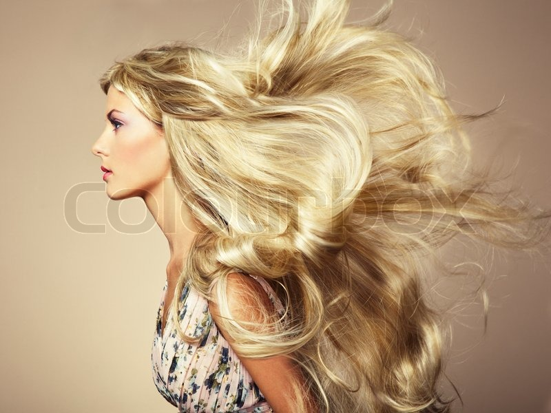 Photo of beautiful woman with magnificent hair. Fashion photo, stock photo