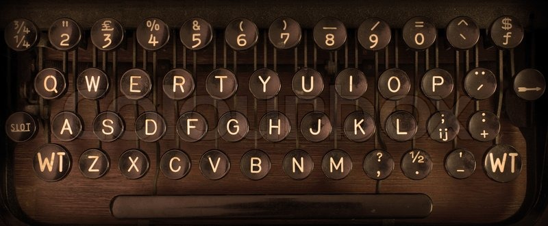 Close up of a dirty vintage typewriter, warm filter, stock photo