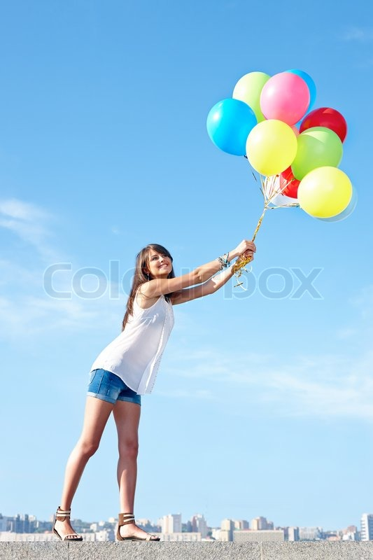 Happy Young Woman Flying Away With ... | Stock Photo ...