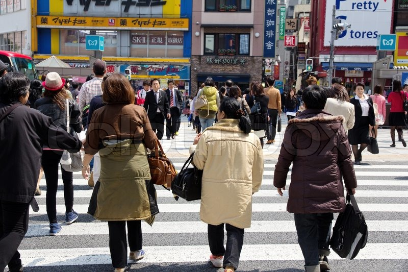 Tokyo, Japan - April15, 2014 : Tourists and business people crossing the street at Shibuya in April15, 2014, the most important commercial center in Tokyo, Japan, stock photo