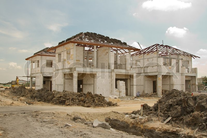 Building & Construction Site in progress to new house, stock photo