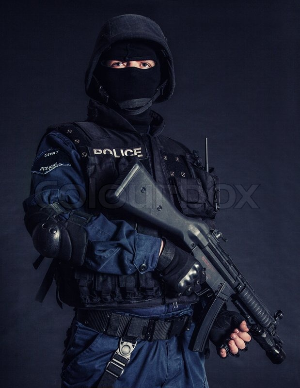 Special weapons and tactics SWAT team officer on black background ...