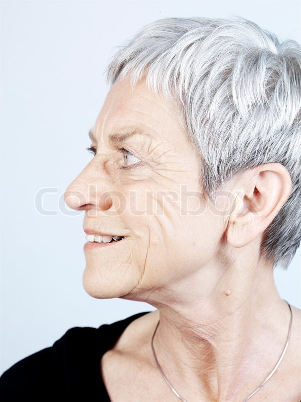 Side View Of An Elderly Woman With Short Hair Stock Photo Colourbox