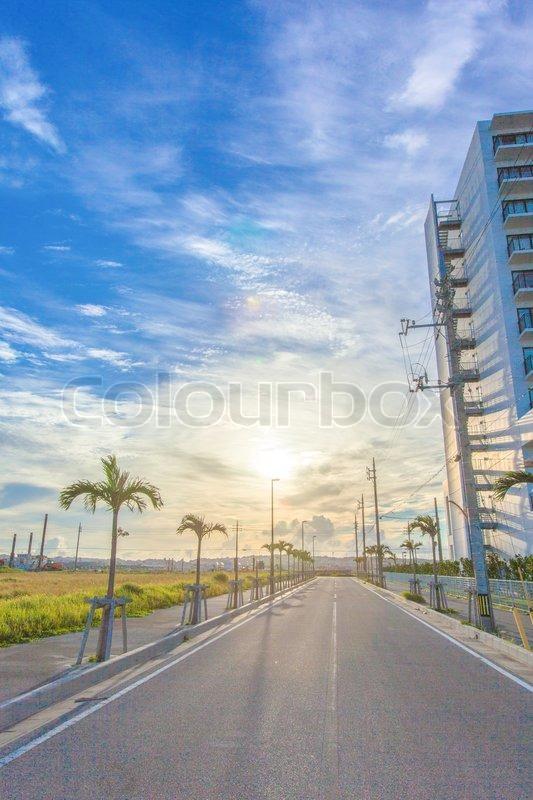 Sun and blue sky with asphalt road, stock photo