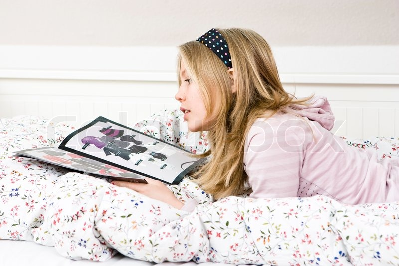 teen girls looking at porn mags
