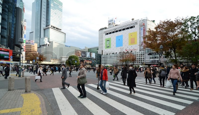 TOKYO - NOVEMBER 28: Crowds of people crossing the center of Shibuya in November 28 2013, the most important commercial center in Tokyo, Japan , stock photo