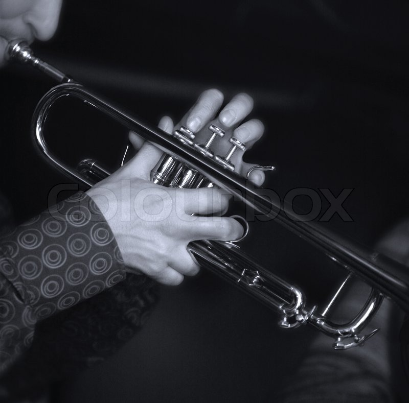 Trumpet player. Focus on the finger of the saxophone player. b/w+blue tone, stock photo
