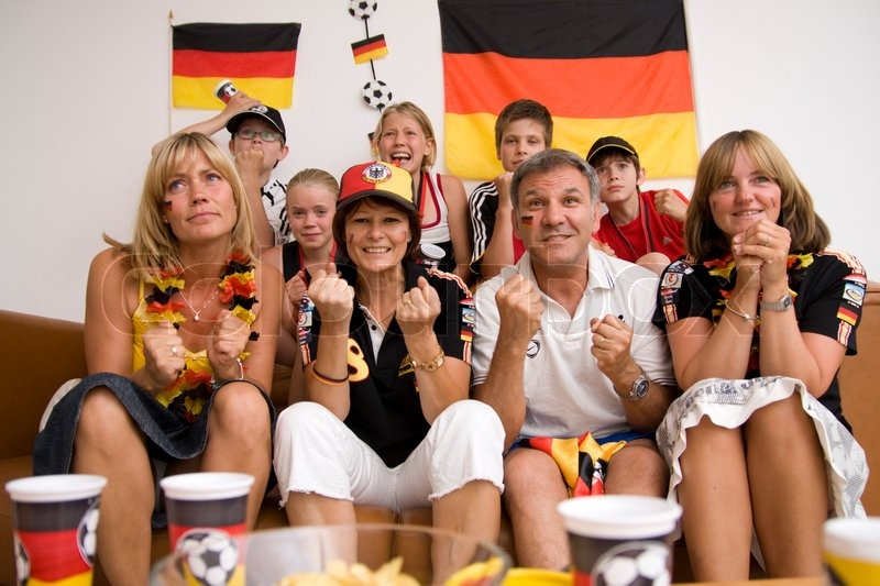 Excited faces of german football fans, stock photo