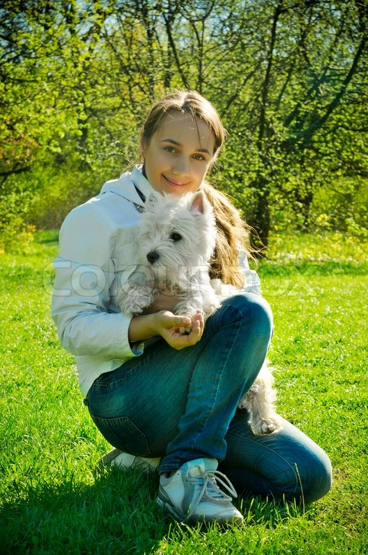 Woman with dog in the park, stock photo