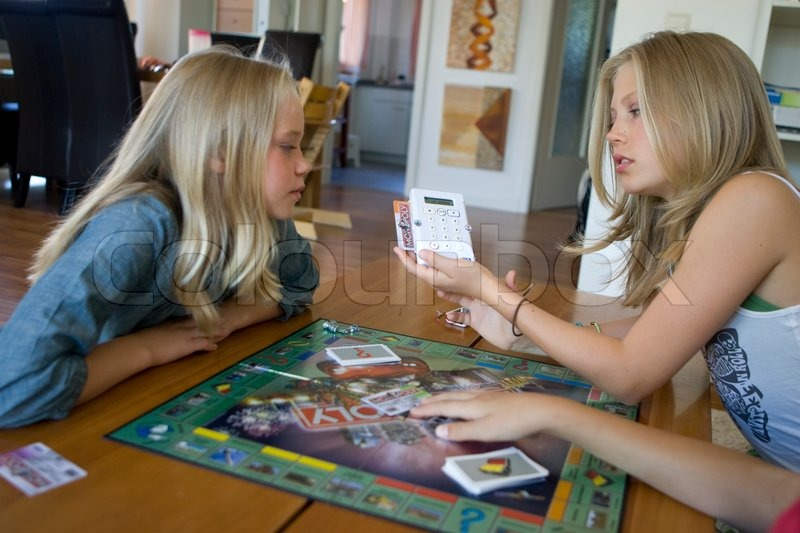 Teenage girls playing board game | Stock Photo | Colourbox