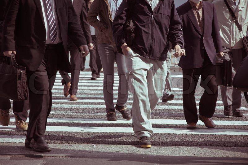 People commuting in rush hour at zebra crossing,Tokyo japan, stock photo