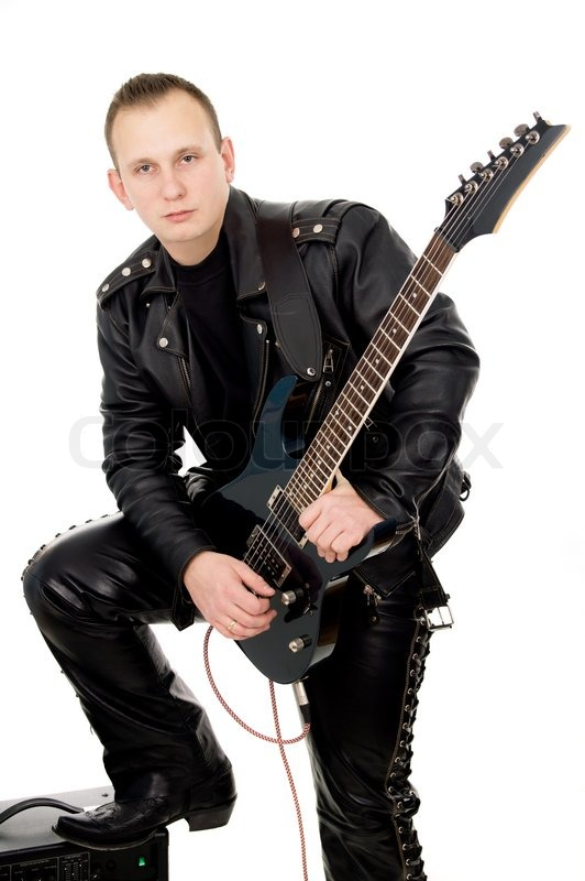 guy rock guitarist in leather garments plays guitar isolated on