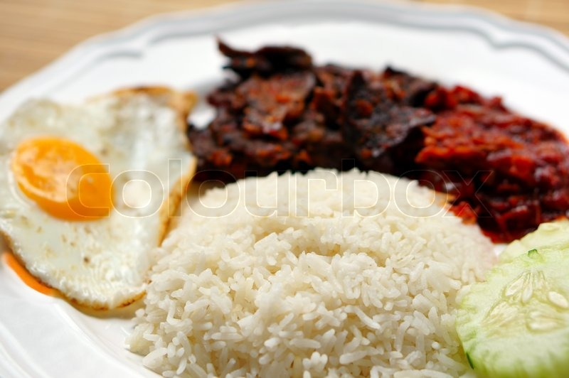 Nasi lemak (coconut rice) served with sunny side up egg, hot spicy