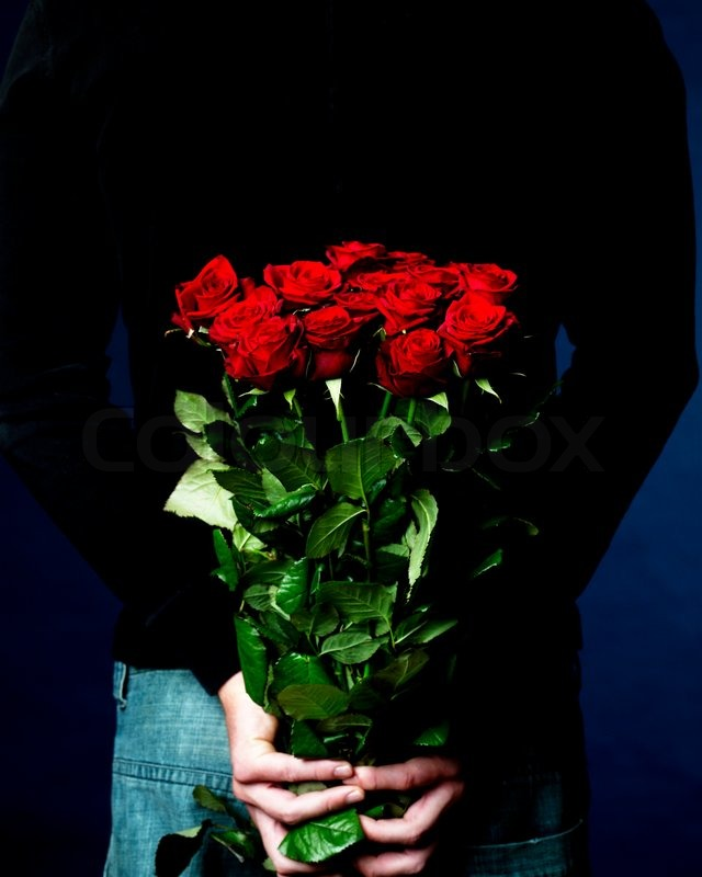 A man holding a bouquet of red roses for Valentine\'s day | Stock ...