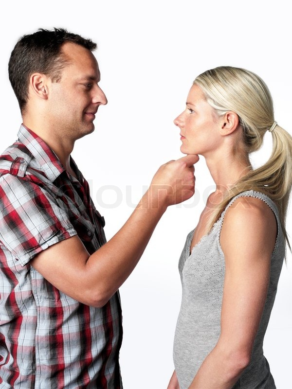 A Man In Love Holding The Chin Of His Girlfriend Stock