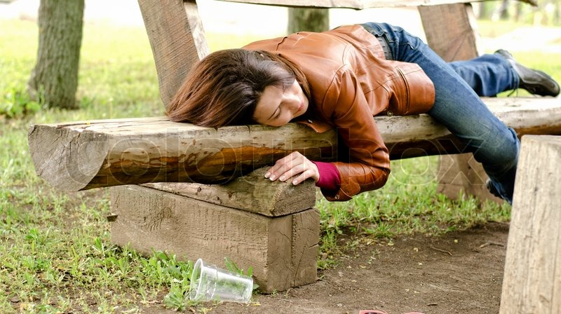 Drunk Woman Sleeping It Off On A Wooden Stock Photo