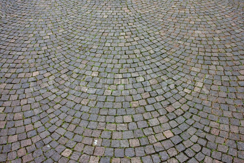 Stone pathway with curved parts, historic architecture background, stock photo