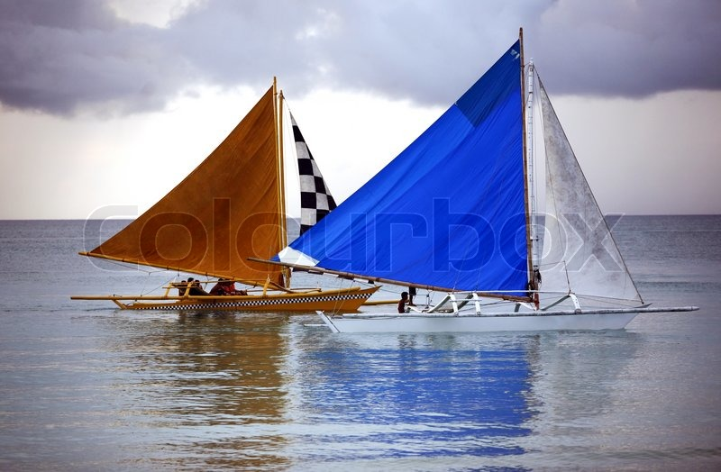 Two sailing boat at an open ocean, stock photo