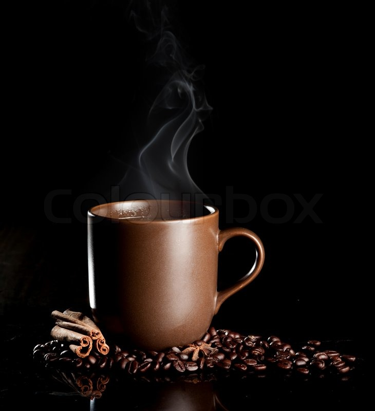 Aromatic cup of coffee with smoke and beans, stock photo