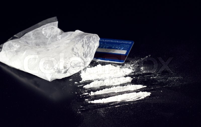 Cocaine Powder Heap On Black Table With Bank Card