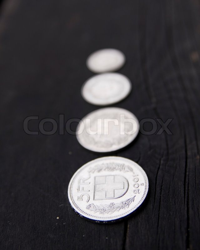 Stock image of 'Blurred image of swiss coins'
