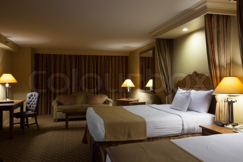 View Of Nice Big Interior Of Hotel Room Night Time