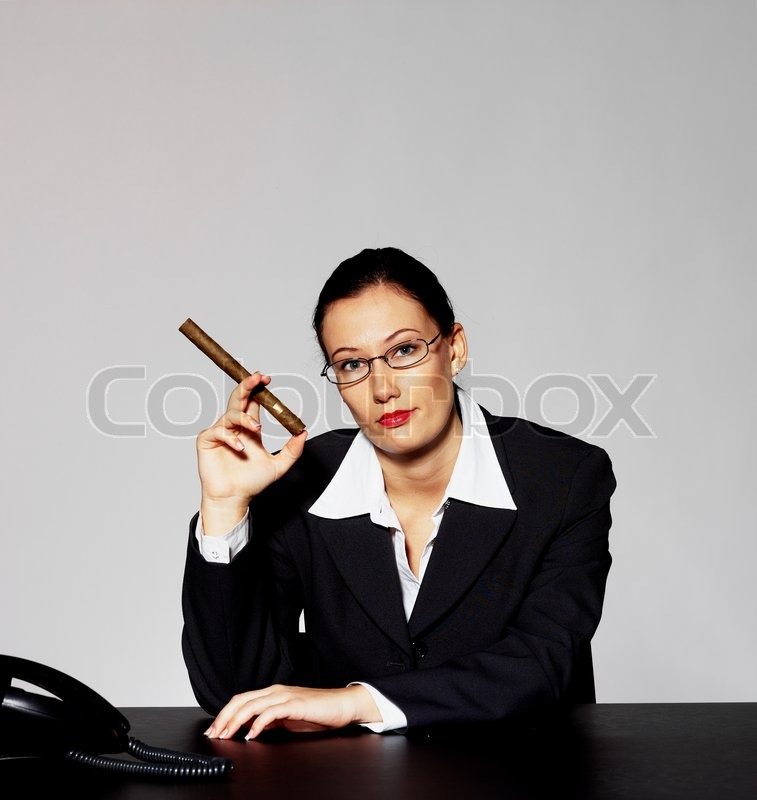 A Businesswoman With A Cigar Stock Photo Colourbox