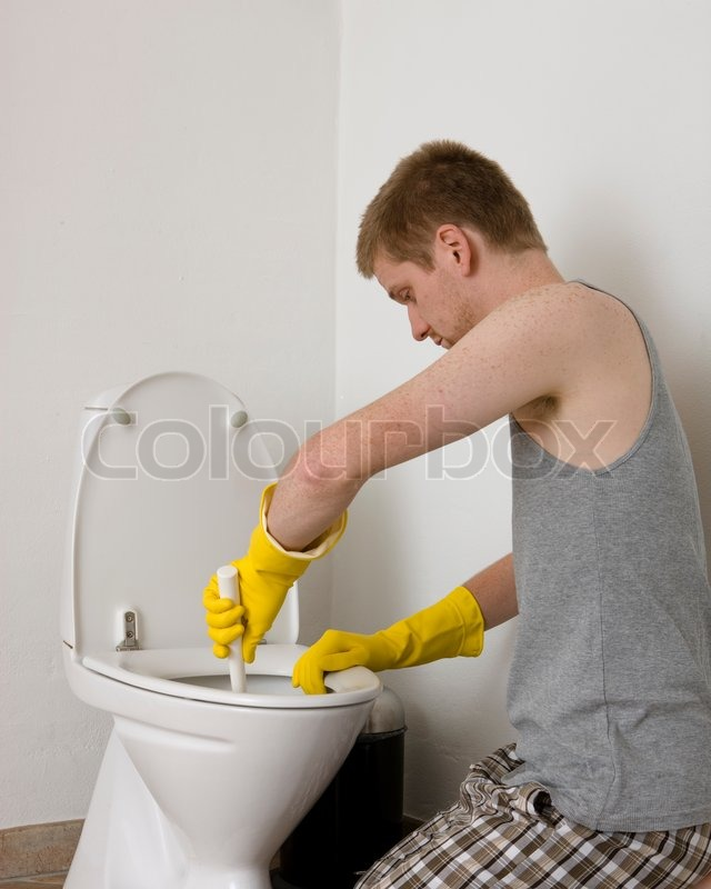 man cleaning bathroom