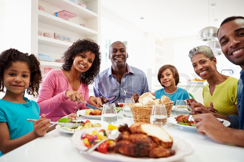 Multi Generation African American Family Eating Meal At