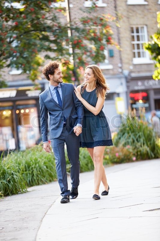 Two people holding hands walking