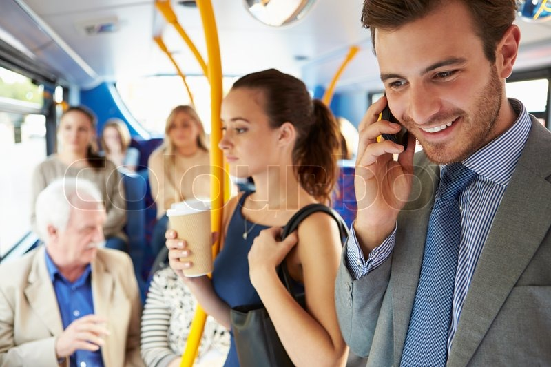 Passengers Standing On Busy Commuter Bus, stock photo