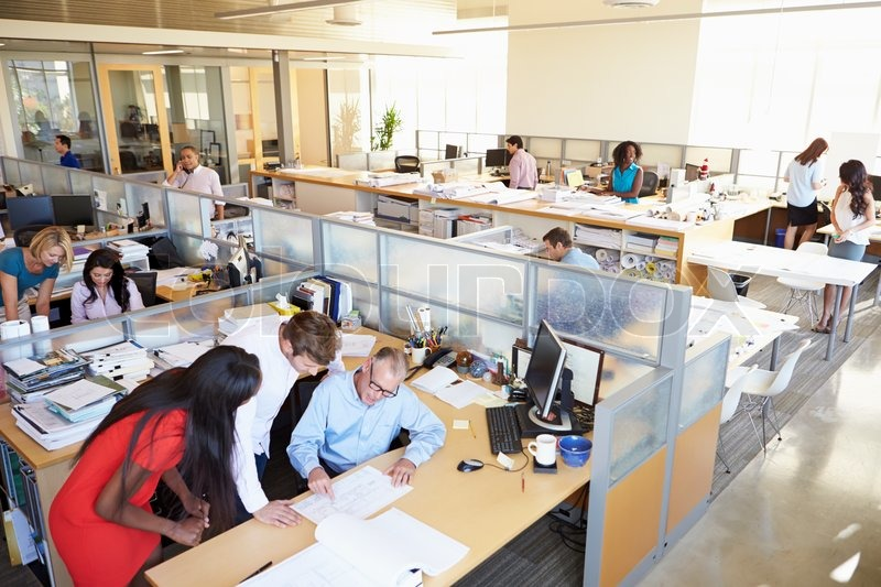 Interior Of Busy Modern Open Plan Office, stock photo