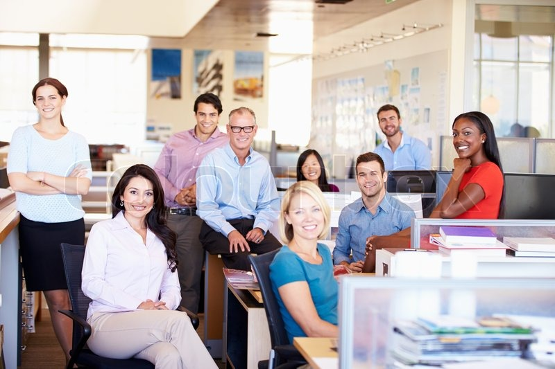 Portrait Of Businesspeople In Modern Open Plan Office, stock photo