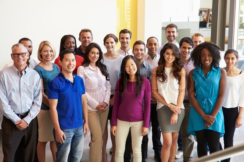 Portrait Of Multi-Cultural Office Staff Standing In Lobby, stock photo