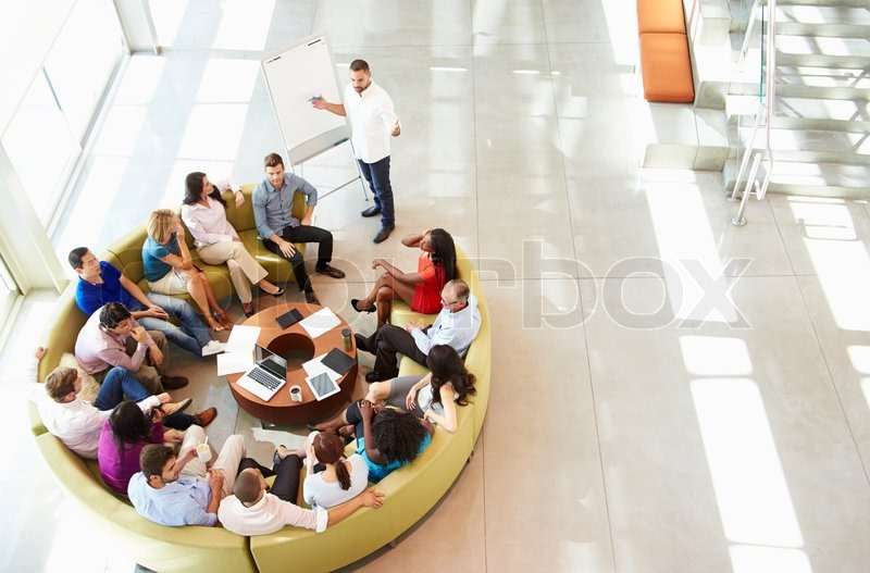 Businessman Making Presentation To Office Colleagues, stock photo