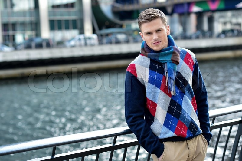 Young stylish man leaning on metal railing stock photo for Irish mail cart plans