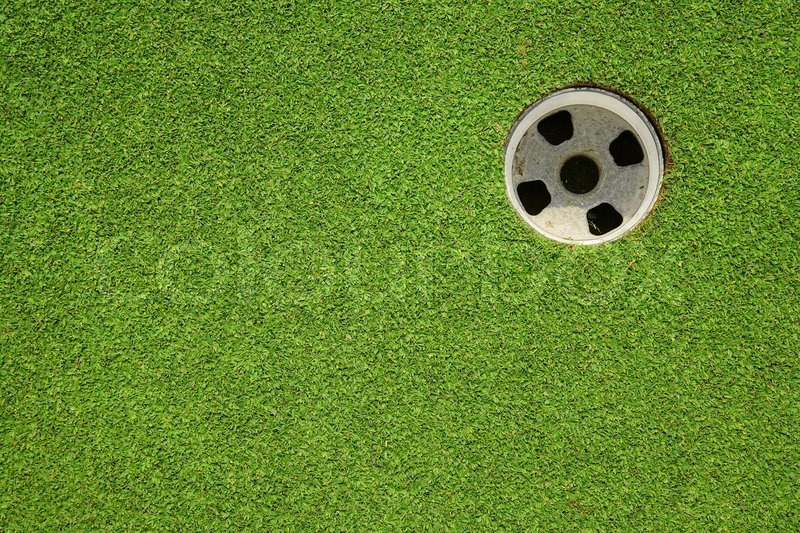 Golf hole on a field, stock photo