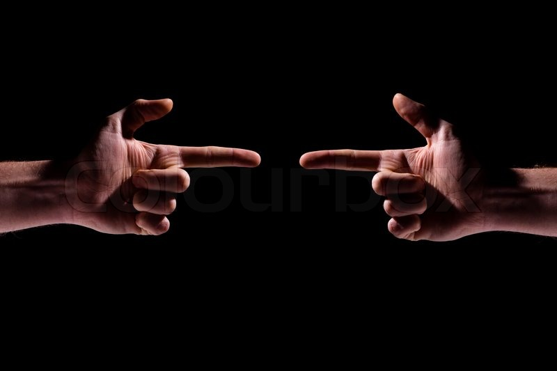Two hands pointing at each other over black background, stock photo