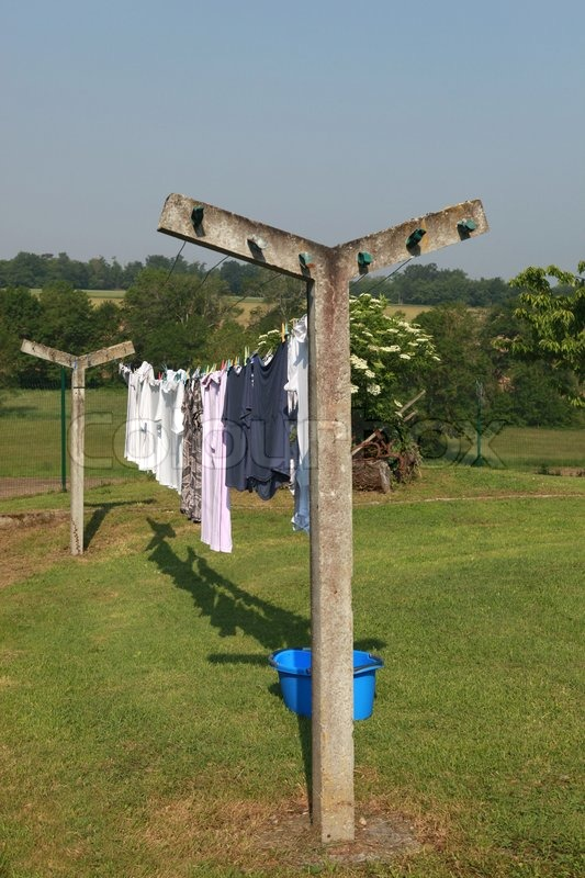 Clothes Drying On A Clothesline ~ Clothes drying on a clothesline stock photo colourbox