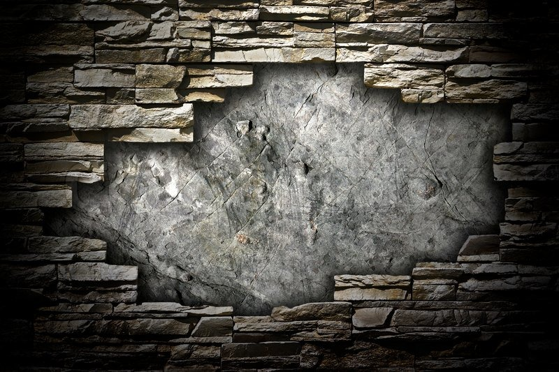 Stone wall with a large hole in the middle of a grunge ...