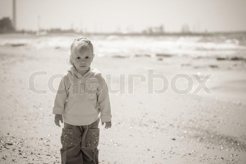 Little girl on sea, black and white photo, stock photo