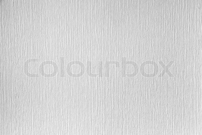 White paintable wallpaper on the wall. Clean background photo texture, stock photo