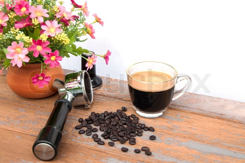 Hot coffee and coffee making equipment with flower clay pot, stock photo