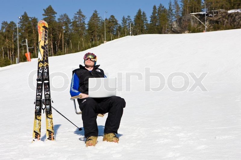 Relaxing With A Laptop At Kongsberg Ski Stock Photo