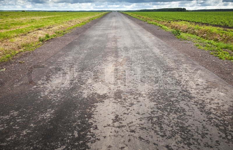 Empty asphalt country road perspective with horizon line, stock photo