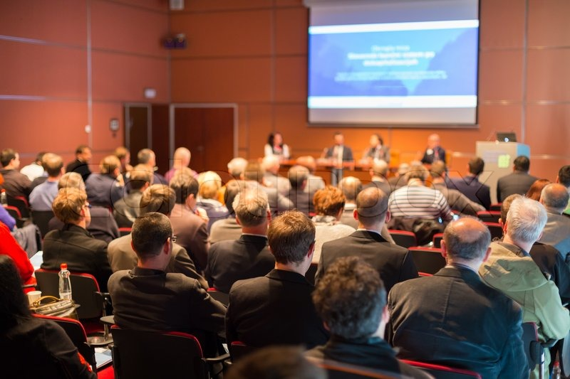 Business Conference and Presentation. Audience at the conference hall, stock photo