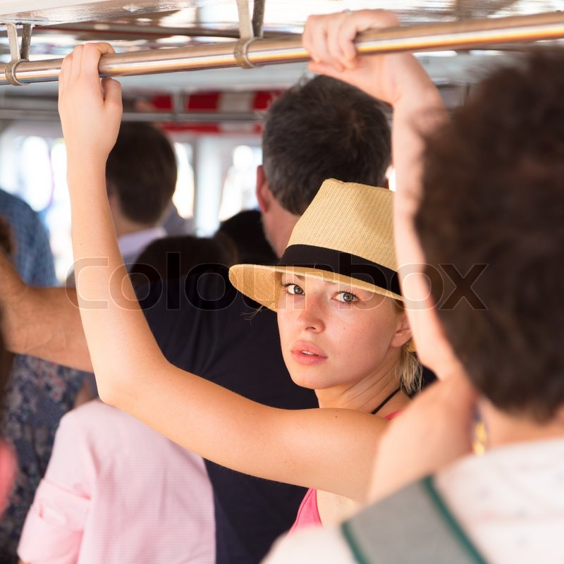 Blonde caucasian lady traveling by public transport, stock photo