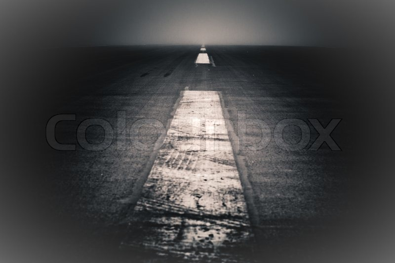 Abstract creative photo of dramatic dark road and sky, stock photo